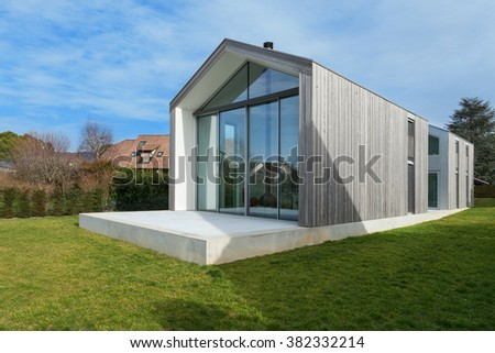 Exterior of a beautiful modern house, view from lawn - stock photo