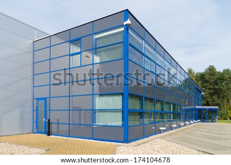 exterior of a modern blue office building - stock photo