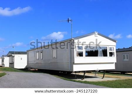 Exterior of a modern caravan on a trailer park in summer, England. - stock photo