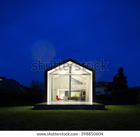 Exterior of a modern house, night scene