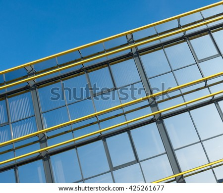 exterior of a modern office building with yellow decorations