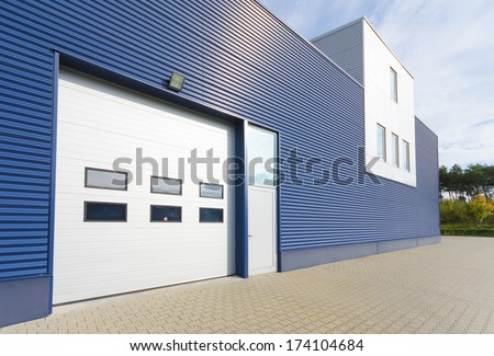 exterior of a modern warehouse with office unit - stock photo