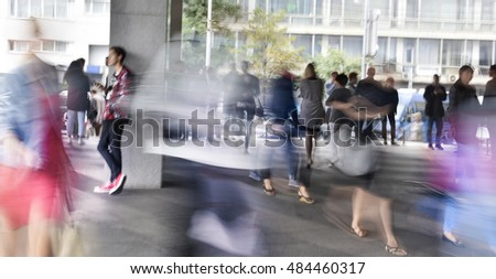exterior of an office building, people moving.