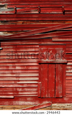 Exterior of an old red barn - stock photo