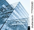 exterior of contemporary glass business center - stock photo