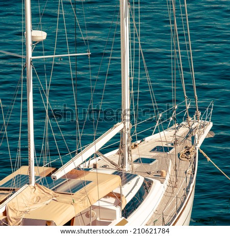 Exterior of cruising yacht - deck, portholes and mast. Yachting tourism - romantic trip on classic yacht. Nautical equipping and marine tools on sailboat - tackles on the yacht. - stock photo