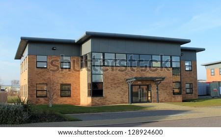 Exterior of empty modern office building to let on business park.