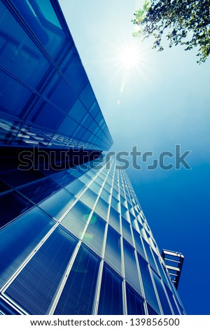 exterior of glass residential building. Modern glass silhouettes of skyscrapers - stock photo