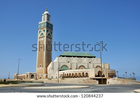 Exterior of Hassan II mosque with blue sky background and road at the forefront, Casablanca, Morocco