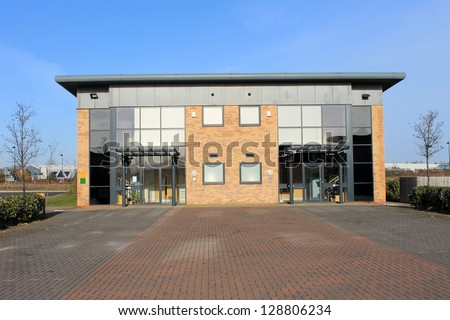 Exterior of large modern office building on business park. Unit is empty and available for rent. - stock photo