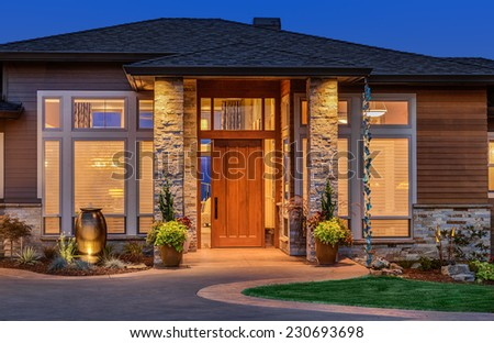 Exterior of luxury home in evening - stock photo