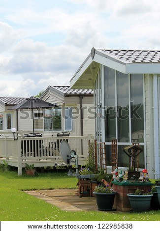Exterior of mobile caravan homes in modern trailer park. - stock photo