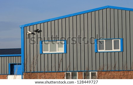 Steel building stock images royalty free images vectors for Factory exterior design