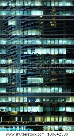Exterior of office building at night - stock photo