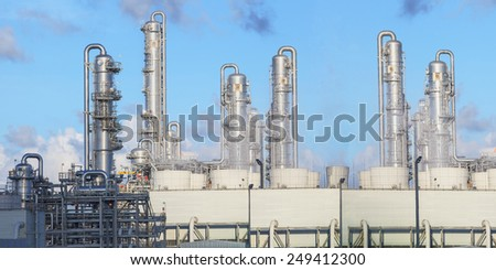 exterior of oil refinery chimney tube building  in heavy petroleum and  petrochemical industry estate use for fussil fuel,energy and gas power industrial - stock photo
