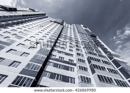 Exterior of the new apartment building after construction finish. - stock photo