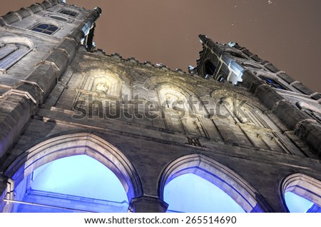 Exterior of the Notre-Dame basilica cathedral in Montreal, Canada on a snowy evening. The church's Gothic Revival architecture is among the most dramatic in the world. - stock photo
