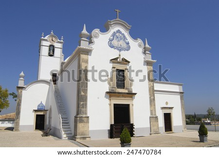 Exterior of the Saint Lawrence of Rome church in Almancil, Portugal. Church has one of the most beautiful in Portugal hand painted tiles (Azulejo) of the 18th century at the facade. - stock photo