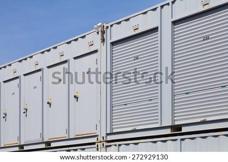 Exterior of white storage unit or small warehouse for rental - stock photo