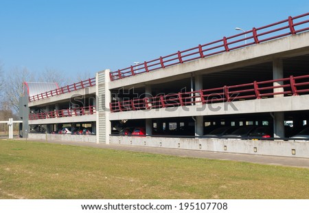 exterior or a three floors parking garage - stock photo