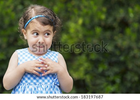 Exterior photo, 3 year old girl with mischievous expression