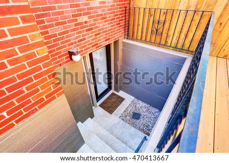 Exterior Steps Lead To Underground Basement Of The Brick House. Northwest,  USA