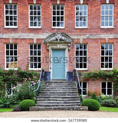 Exterior View of a Beautiful Georgian Era Red Brick English Mansion - stock photo
