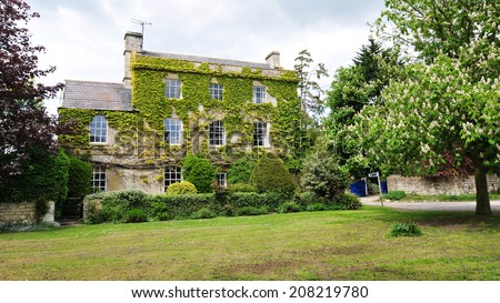 Exterior View of a Beautiful Old English Detached House on a Village Green - stock photo