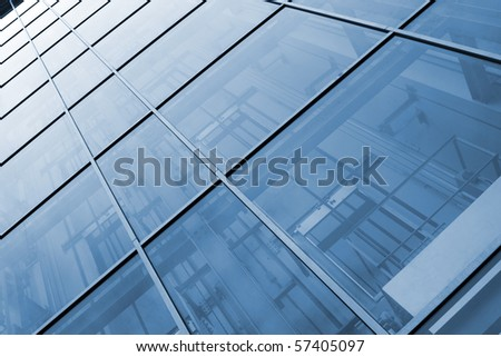 Exterior view of an office building with blue tint - stock photo