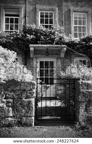 Exterior View of an Old English Cottage in Black and White