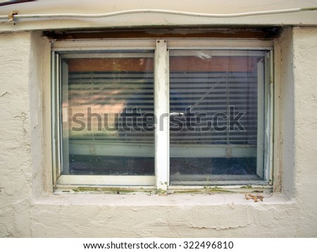 exterior view of an old home window - stock photo