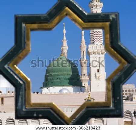 Exterior view of minarets and green dome of a mosque taken off the compound. masjid Al Nabawi minaret and green dome in Madinah, Saudi Arabia