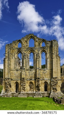 Exterior view of Rievaulx Abbey under cloudscape, North Yorkshire, England.