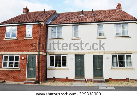 Exterior View of Terraced Houses on an English Residential Estate - stock photo