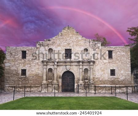 Exterior view of the historic Alamo in San Antonio, TX with a rainbow overhead - stock photo