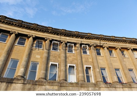 Exterior View of Town Houses on the Royal Crescent in Bath England Bathed in Warm Evening Sunlight - The Royal Crescents Consists of Thirty Georgian Era Luxury Town Houses - stock photo
