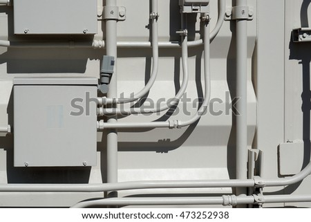 Exterior wall of electrical boxes and conduit.