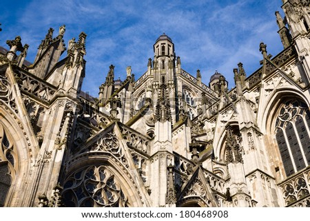 Exterior with many gothic details against a deep blue sky of the gothic medieval cathedral of Saint John, one of the top attractions of Den Bosch, 's-Hertogenbosch, Netherlands - stock photo