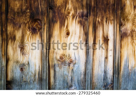 Exterior wooden wall made of stained brown vertical battens, rustic architectural detail from Swiss Alps. - stock photo