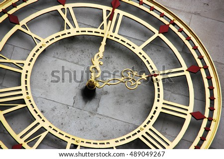 External clock on wall in town or city centre