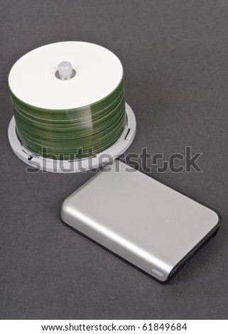 External Computer Hard Drive and CD-R Bundle ( Technology Concept ) - stock photo