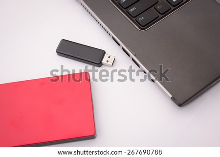 External hard disk and laptop computer - stock photo