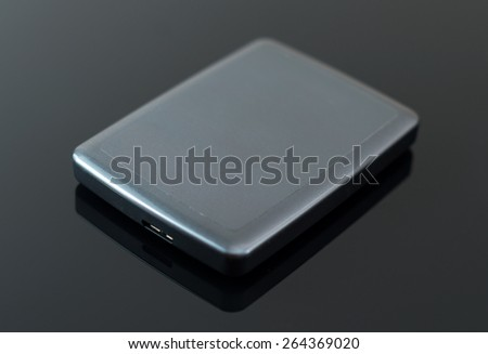 External usb hard drive on the black table. - stock photo