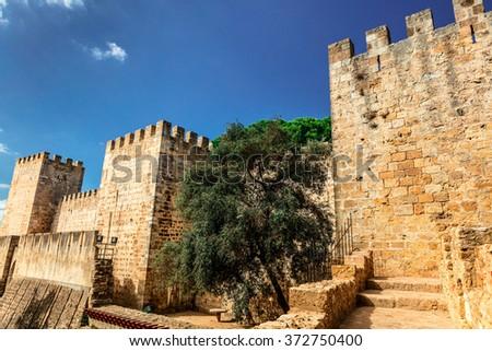 External wall and towers of the Lisbon Castle (Castelo de Sao Jorge). - stock photo