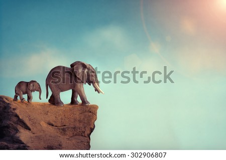 extinction concept elephant family on edge of cliff