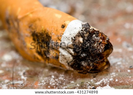 Extinguished cigarette butt in an ashtray - stock photo
