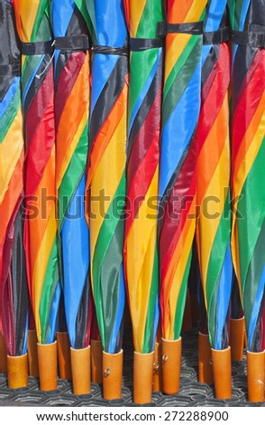 Extra bright colorful umbrellas texture.Colors of rainbow, lines of spiral. Useful for background - stock photo