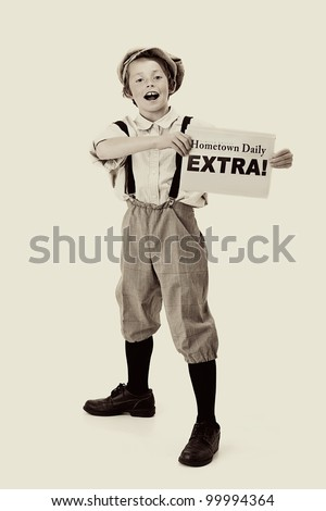 Extra, extra: vintage newsboy holds out his paper for sale - stock photo