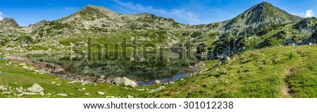 Extra high resolution detailed landscape panorama of Bucura lake in Retezat National Park mountains, South Carpatians, Transylvania, Romania, Europe. Small lake with blue sky reflection at center. - stock photo