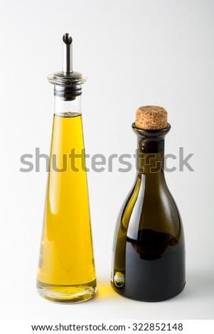 Extra virgin olive oil and Balsamic vinegar on white background - stock photo